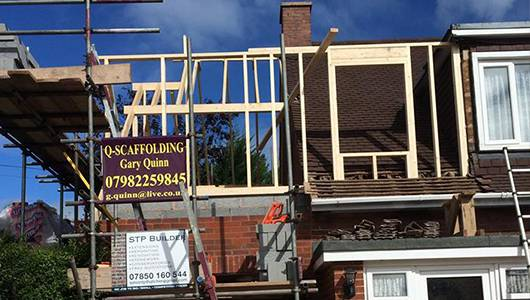Scaffolding and roofing set up for extension services